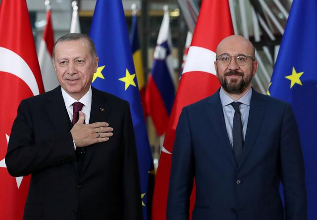 FILE PHOTO: Turkish President Tayyip Erdogan and EU Council President Charles Michel pose in Brussels, Belgium March 9, 2020. REUTERS/Yves Herman/File Photo