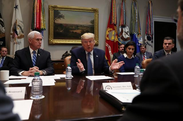 U.S. President Donald Trump speaks next to Vice President Mike Pence during a coronavirus briefing with health insurers in the Roosevelt Room of the White House in Washington, U.S., March 10, 2020. REUTERS/Leah Millis