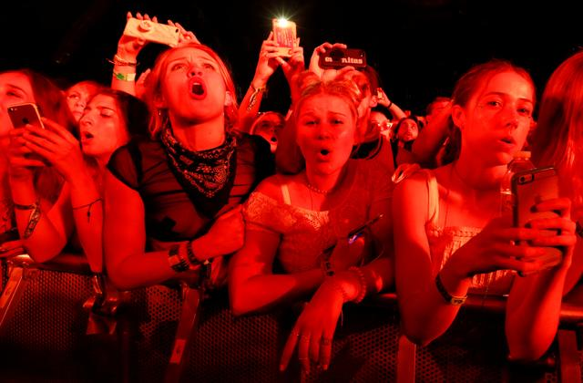Concertgoers watch a performance by Post Malone at the Coachella Valley Music and Arts Festival in Indio, California, April 14, 2018. Picture taken April 14, 2018. REUTERS/Mario Anzuoni