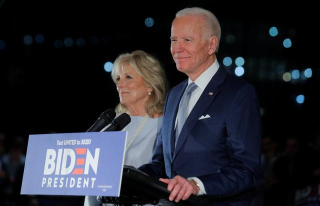 Democratic U.S. presidential candidate and former Vice President Joe Biden speaks with his wife Jill at his side during a primary night speech at The National Constitution Center in Philadelphia, Pennsylvania, U.S., March 10, 2020. REUTERS/Brendan McDermid