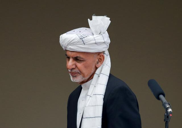 FILE PHOTO: Afghanistan's President Ashraf Ghani arrives to his inauguration as president, in Kabul, Afghanistan March 9, 2020. REUTERS/Mohammad Ismail/File Photo