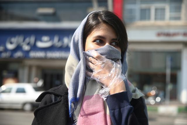 FILE PHOTO: An Iranian woman wears a protective face mask, following the coronavirus outbreak, as she walks in Tehran, Iran March 5, 2020. WANA (West Asia News Agency)/Nazanin Tabatabaee via REUTERS ATTENTION EDITORS - THIS IMAGE HAS BEEN SUPPLIED BY A THIRD PARTY./File Photo