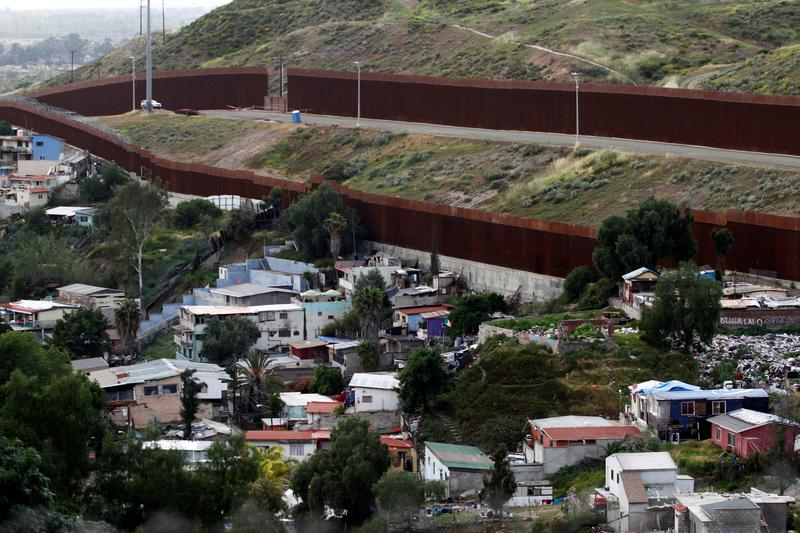 Mexicans wonder if Trump's wall could stop coronavirus spreading south