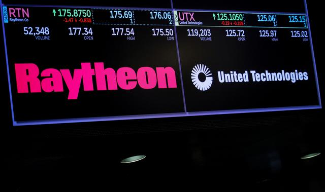 FILE PHOTO: A screen shows the logos and trading information for defense contractor Raytheon Co, and United Technologies Corp. on the floor at the New York Stock Exchange (NYSE) in New York, U.S., June 17, 2019. REUTERS/Brendan McDermid