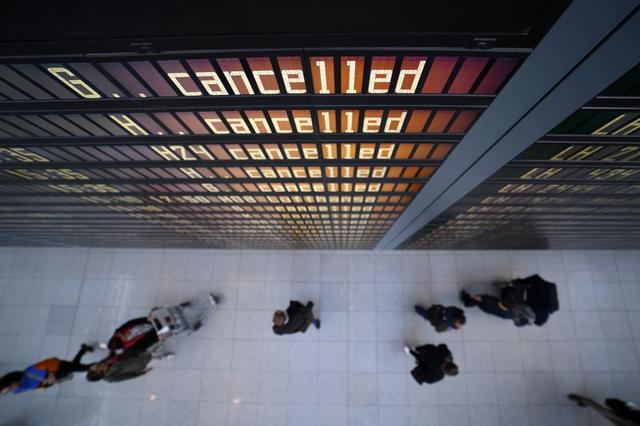 FILE PHOTO: A display board shows most flights as cancelled at the airport in Munich, Germany, February 10, 2020. REUTERS/Andreas Gebert/File Photo