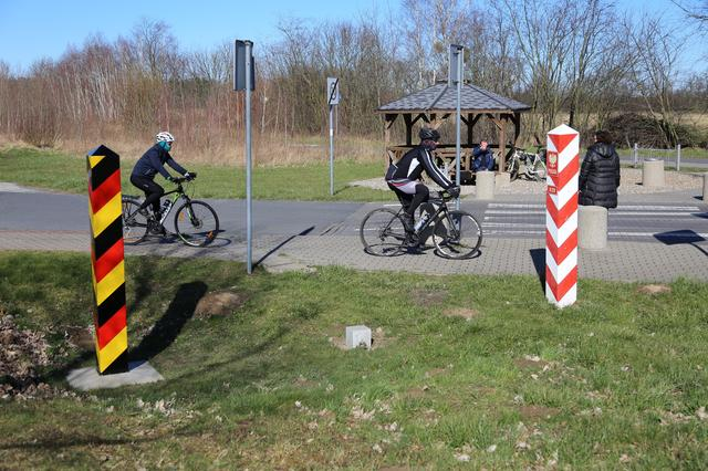 FILE PHOTO: People bike at the local border crossibg between Poland and Germany in Buk - Blankensee, Poland March 14, 2020. Poland will close its borders from March 15, 2020 as a preventive measure against the coronavirus (COVID-19) in Budzisko, Poland March 14, 2020. Cezary Aszkielowicz/Agencja Gazeta via REUTERS