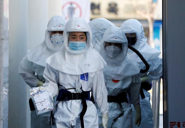 FILE PHOTO: Medical workers head to a hospital facility to treat coronavirus patients amid the rise in confirmed cases of coronavirus disease (COVID-19) in Daegu, South Korea, March 14, 2020. REUTERS/Kim Kyung-Hoon