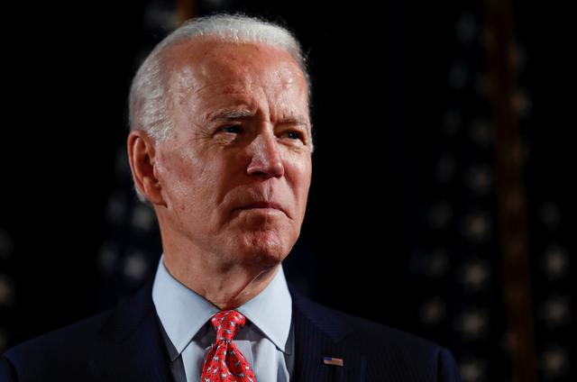 FILE PHOTO: Democratic U.S. presidential candidate and former Vice President Joe Biden speaks about responses to the COVID-19 coronavirus pandemic at an event in Wilmington, Delaware, U.S., March 12, 2020. REUTERS/Carlos Barria