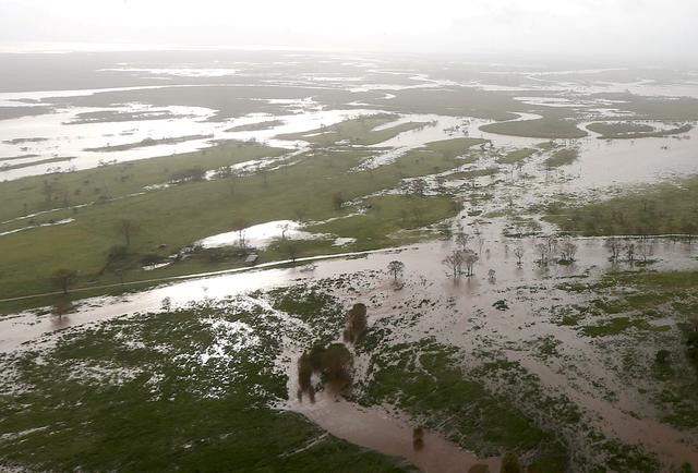 FILE PHOTO: Flooded areas can be seen from an Australian Army helicopter after Cyclone Debbie passed through the area near the town of Bowen, located south of the northern Queensland town of Townsville in Australia, March 30, 2017.  REUTERS/Gary Ramage/Pool/File Photo
