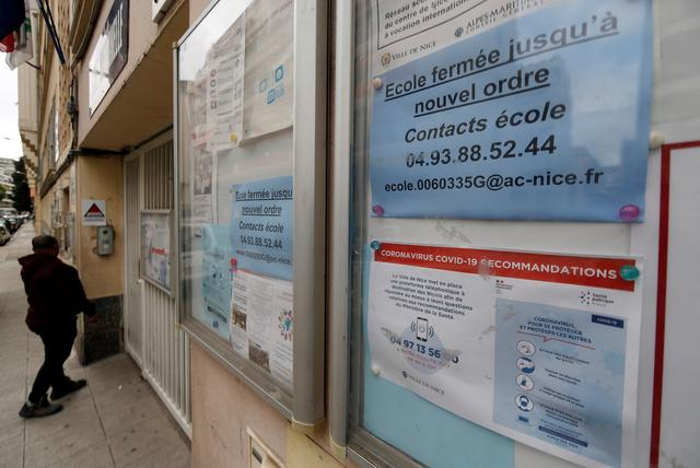 FILE PHOTO: An information sign is seen at a school in Nice as France will close from Monday all nurseries, schools and universities to try to slow the spread of the coronavirus disease (COVID-19), France, March 13, 2020. REUTERS/Eric Gaillard