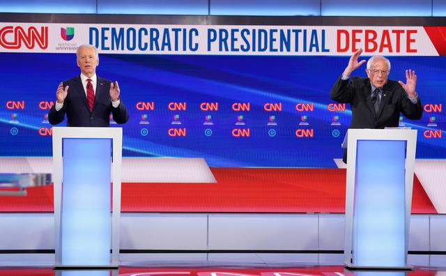 Democratic U.S. presidential candidates former Vice President Joe Biden and Senator Bernie Sanders debate during the 11th Democratic candidates debate of the 2020 U.S. presidential campaign, held in CNN's Washington studios without an audience because of the global coronavirus pandemic, in Washington, U.S., March 15, 2020. REUTERS/Kevin Lamarque