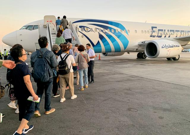 FILE PHOTO: Tourists take Luxor-bound EgyptAir flight from Cairo International Airport in Cairo, Egypt October 9, 2019. REUTERS/Mohamed Abd El Ghany/File Photo