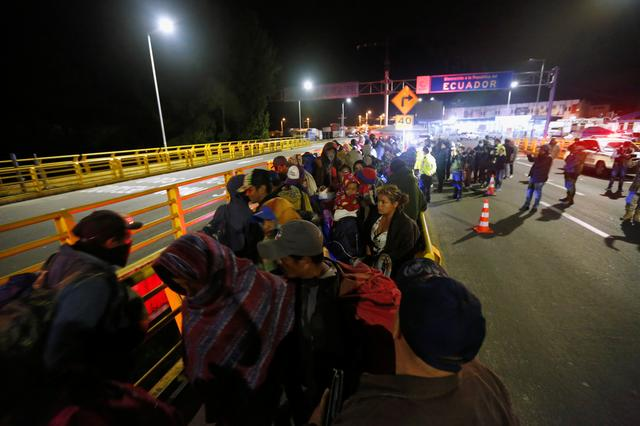 Stranded migrants, mostly from Venezuela, are pictured at Rumichaca International Bridge between Colombia and Ecuador, after Ecuador's government closed its borders to all foreign travelers due to the spread of the coronavirus disease (COVID-19), in Tulcan, Ecuador, March 16, 2020. REUTERS/Daniel Tapia