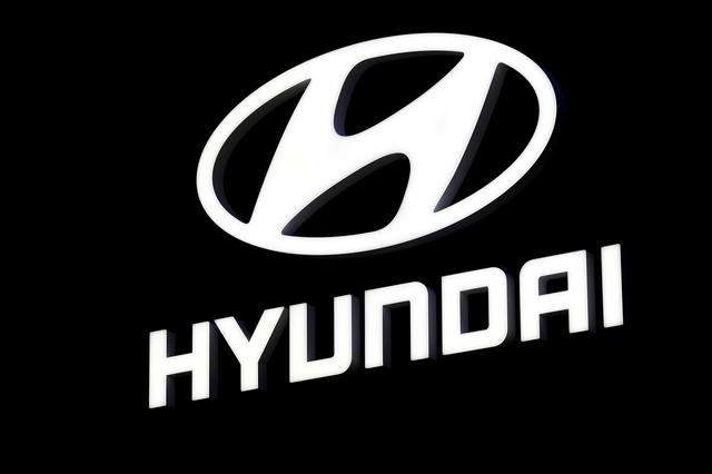 FILE PHOTO: The Hyundai booth displays the company logo at the North American International Auto Show in Detroit, Michigan, U.S. January 16, 2018.  REUTERS/Jonathan Ernst