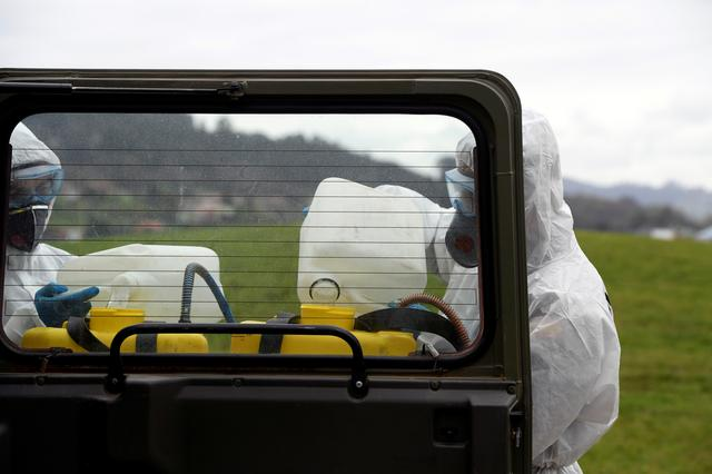 A member of the Military Emergency Unit (UME) disinfects the HUCA (Central University Hospital of Asturias) during a 15-day state of emergency declared to combat the outbreak of the coronavirus disease (COVID-19) in Oviedo, Spain, March 17, 2020.