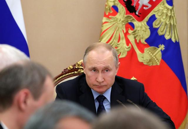 Russian President Vladimir Putin chairs a meeting with members of the government at the Kremlin in Moscow, Russia March 17, 2020. Sputnik/Mikhail Klimentyev/Kremlin via REUTERS