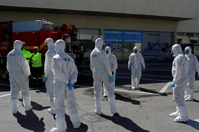 FILE PHOTO: Members of the Military Emergency Unit (UME) prepare to disinfect the Malaga-Costa del Sol international airport during partial lockdown as part of a 15-day state of emergency to combat the coronavirus disease outbreak in Malaga, Spain March 16, 2020. REUTERS/Jon Nazca