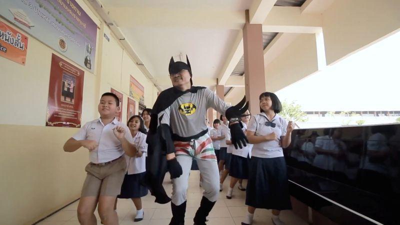 'Corona, corona': Thai Batman fights virus with catchy tune – Reuters