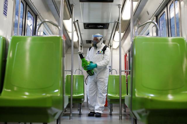 A worker carries out the disinfection of a metro car, as part of Mexico City's government's measures in response to the coronavirus disease (COVID-19), in Mexico City, Mexico March 17, 2020. REUTERS/Gustavo Graf