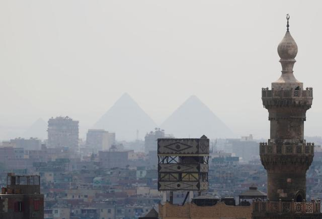 A view of Old Cairo with a mosque minaret and the Great Pyramids following the government instructions as Egypt ramps up its efforts to slow the spread of the coronavirus disease (COVID-19) in Cairo, Egypt March 21, 2020. REUTERS/Amr Abdallah Dalsh