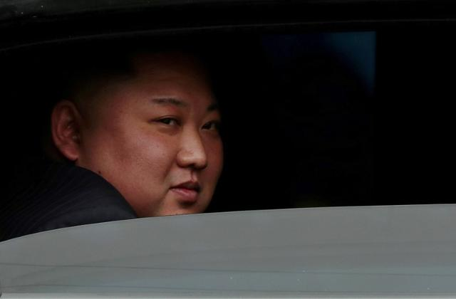 FILE PHOTO: North Korea's leader Kim Jong Un sits in his vehicle after arriving at a railway station in Dong Dang, Vietnam, at the border with China, February 26, 2019. REUTERS/Athit Perawongmetha//File Photo