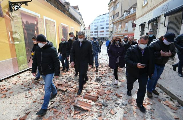 Croatia's Prime Minister Andrej Plenkovic walks at an area affected by an earthquake in Zagreb, Croatia March 22, 2020. REUTERS/Antonio Bronic