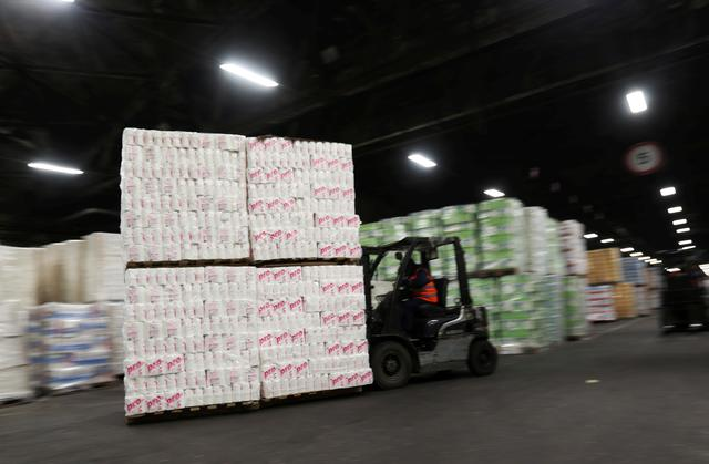 FILE PHOTO: An employee operates a forklift to move pallets of toilet paper at a warehouse of the Syassky Pulp & Paper Mill, as the company increases production due to high demand amid the outbreak of coronavirus disease (COVID-19), in the town of Syasstroy in Leningrad region, Russia March 20, 2020. REUTERS/Anton Vaganov/File Photo
