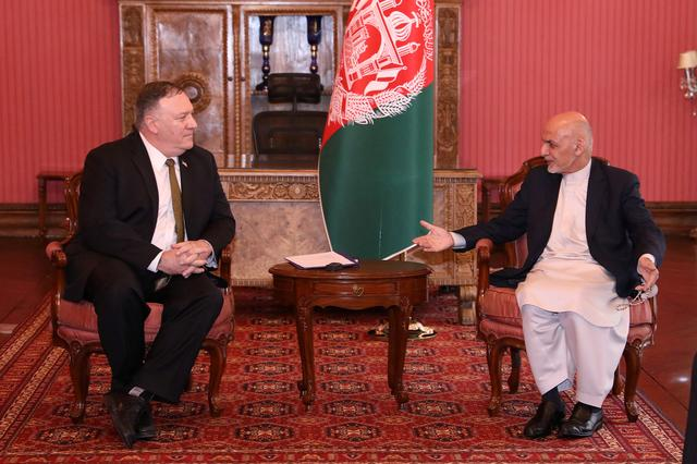 Afghanistan's President Ashraf Ghani (R) meets with U.S. Secretary of State Mike Pompeo in Kabul, Afghanistan March 23, 2020. Afghan Presidential Palace/Handout via REUTERS