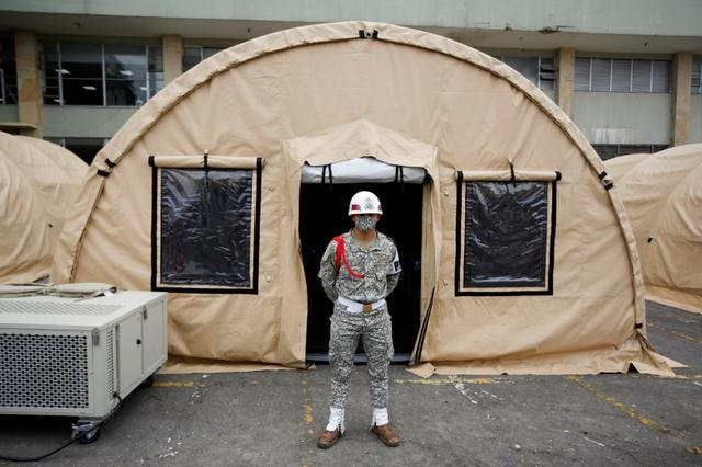 A Colombian soldier stands outside one of the tents being built in a parking lot of the Military Hospital for patients with coronavirus disease (COVID-19), in Bogota, Colombia March 23, 2020. REUTERS/Leonardo Munoz