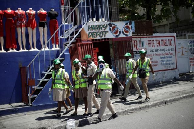 FILE PHOTO: Haitian Boy and Girl Scouts walk along Delmas road during an awareness campaign to prevent the spread of coronavirus disease (COVID-19) in Port-au-Prince, Haiti March 15, 2020. Picture taken March 15, 2020. REUTERS/Andres Martinez Casares