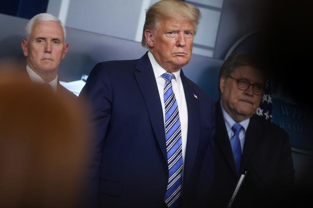 FILE PHOTO: U.S. President Donald Trump, with ‪Vice President Mike Pence and Attorney General Bill Barr‬, leads the daily coronavirus response briefing at the White House in Washington, U.S. March 23, 2020.  REUTERS/Jonathan Ernst