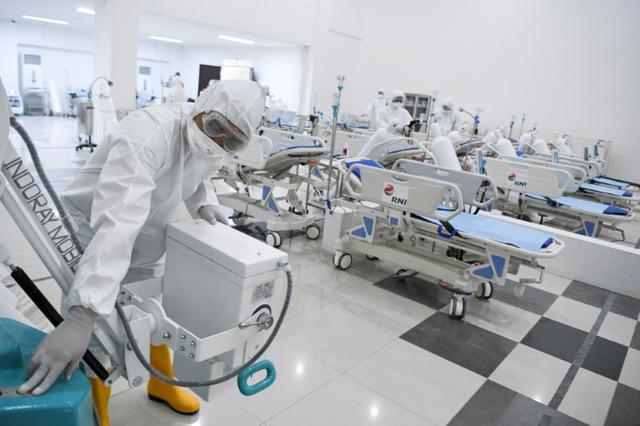 A medical officer checks devices at an emergency hospital, handling coronavirus disease (COVID-19) at Kemayoran Athletes Village, in Jakarta, Indonesia March 23, 2020. Antara Foto/Hafidz Mubarak A via REUTERS