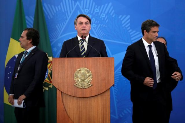 Brazil's President Jair Bolsonaro speaks at media statement announcing economic measures during the coronavirus disease (COVID-19) outbreak in Brasilia, Brazil, March 27, 2020. REUTERS/Ueslei Marcelino