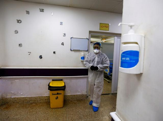 A member of the medical team walks near quarantine room of a hospital, following the outbreak of the new coronavirus, in the holy city of Najaf, Iraq February 24, 2020. REUTERS/Alaa al-Marjani