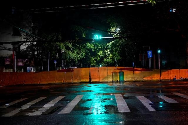 A street blocked by barricades is seen in Wuhan in Hubei province, the epicentre of China's coronavirus disease (COVID-19) outbreak. The city is ending a two month long lockdown by allowing cars to enter, though it still bars them from exiting. March 27, 2020. REUTERS/Aly Song
