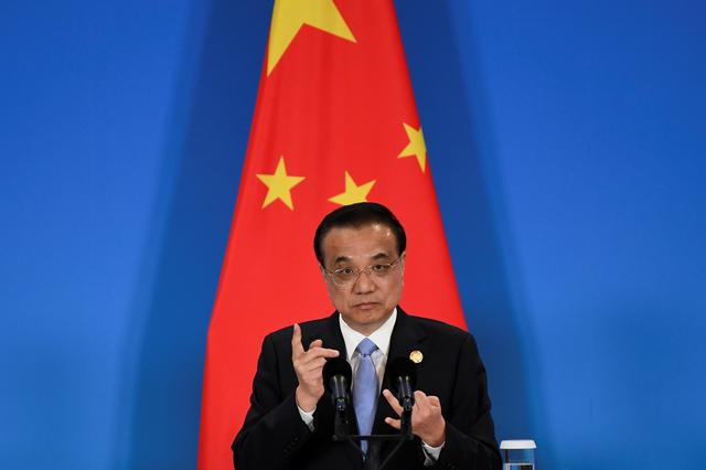 FILE PHOTO: China's Premier Li Keqiang speaks during a joint news conference at the 8th trilateral leaders' meeting between China, South Korea and Japan in Chengdu, in southwest China's Sichuan province December 24, 2019. Wang Zhao/Pool via REUTERS/File Photo