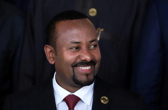 FILE PHOTO: Ethiopian  Prime Minister Abiy Ahmed smiles during the opening of an African Union summit meeting in Addis Ababa, Ethiopia, February 9, 2020. REUTERS/Tiksa Negeri