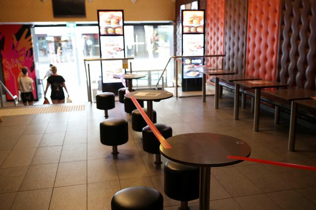A closed McDonald's dining is seen following the implementation of stricter social-distancing and self-isolation rules to limit the spread of the coronavirus disease (COVID-19) in Sydney, Australia, March 31, 2020.  REUTERS/Loren Elliott