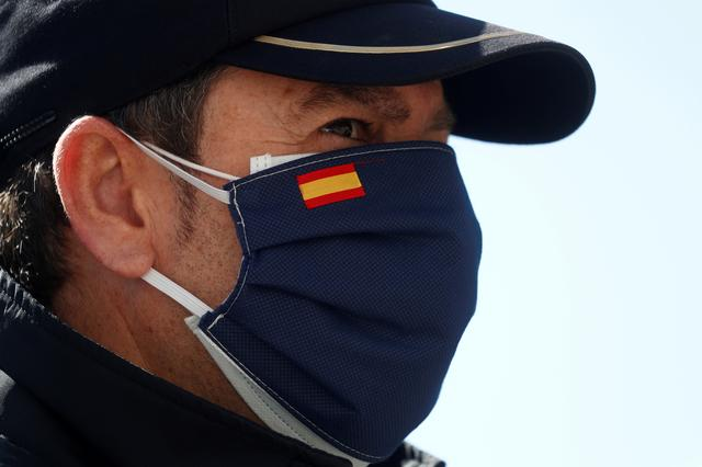 A Spanish National Police officer is seen wearing two protective masks, during the coronavirus disease (COVID-19) outbreak, in Ronda, southern Spain, April 3, 2020. REUTERS/Jon Nazca