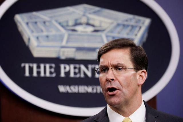 FILE PHOTO: U.S. Defense Secretary Mark Esper speaks during a joint news conference with Britain's Secretary of State of Defence Ben Wallace after their meeting at Pentagon in Arlington, Virginia, U.S., March 5, 2020. REUTERS/Yuri Gripas/File Photo
