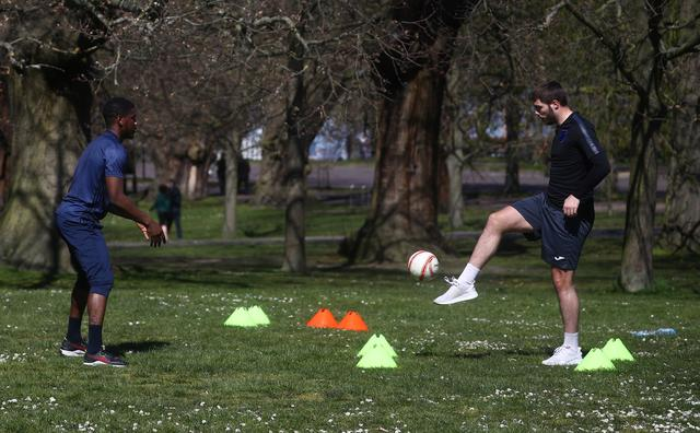 People play football in Greenwich Park, as the spread of the coronavirus disease (COVID-19) continues, London, Britain, April 4, 2020. REUTERS/Hannah McKay