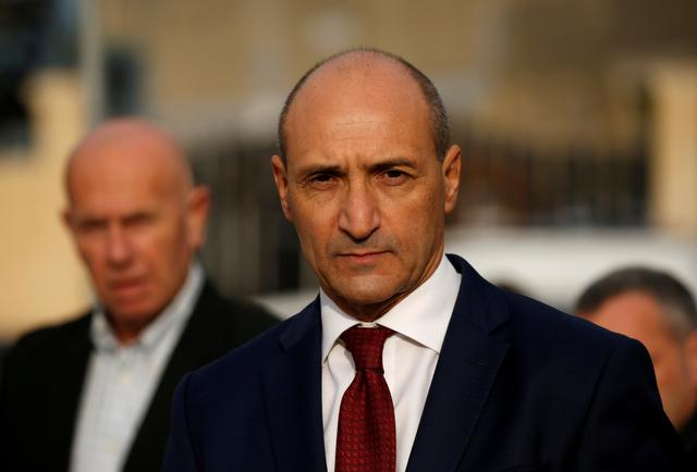 FILE PHOTO: Maltese Health Minister Chris Fearne talks to the media after a fire destroyed part of a reception centre for migrants in Marsa, Malta, January 8, 2020. REUTERS/Darrin Zammit Lupi/File Photo