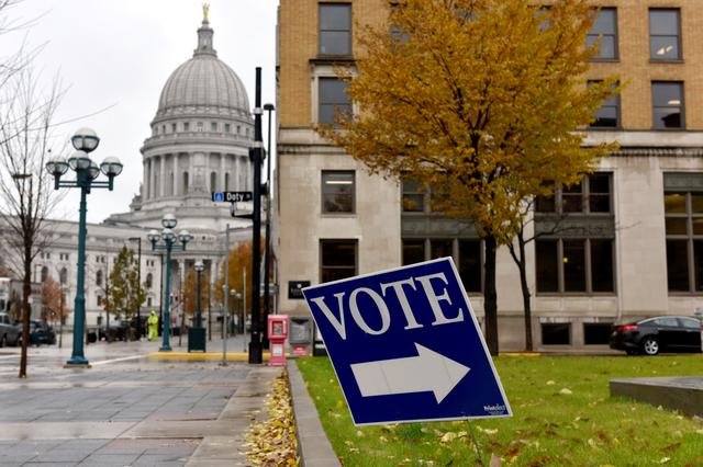 FILE PHOTO: A sign directs voters towards a polling place near the state capitol in Madison, Wisconsin, U.S. November 6, 2018. REUTERS/Nick Oxford