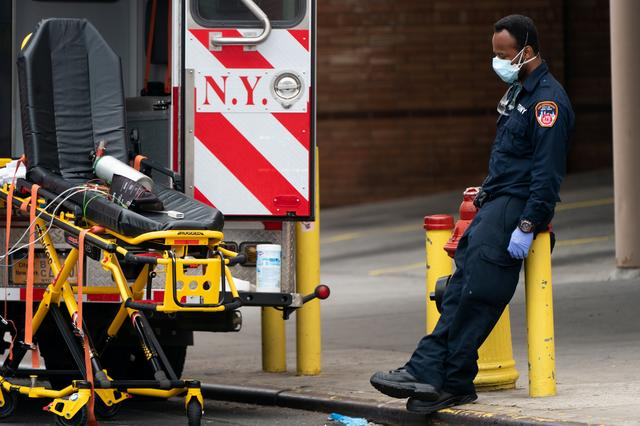A healthcare worker takes a break outside Wyckoff Heights Medical Center during the outbreak of the coronavirus disease (COVID-19) in New York City, U.S., April 5, 2020. REUTERS/Jeenah Moon