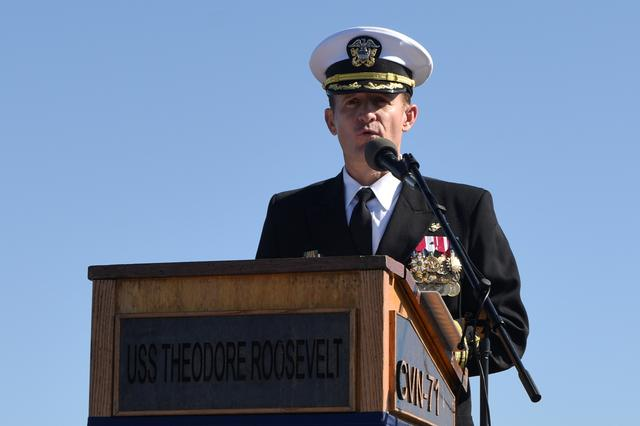 FILE PHOTO: Captain Brett Crozier addresses the crew for the first time as commanding officer of the aircraft carrier USS Theodore Roosevelt during a change of command ceremony on the ship's flight deck in San Diego, California, U.S. November 1, 2019.  U.S. Navy/Mass Communication Specialist 3rd Class Sean Lynch/Handout via REUTERS.