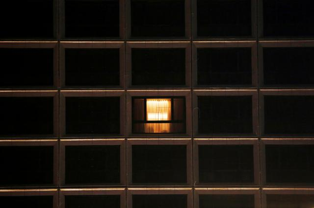 FILE PHOTO: A window with lights on is seen at a hotel, following the coronavirus disease (COVID-19) outbreak, in Hong Kong, China March 25, 2020. Picture taken March 25, 2020. REUTERS/Tyrone Siu/File Photo