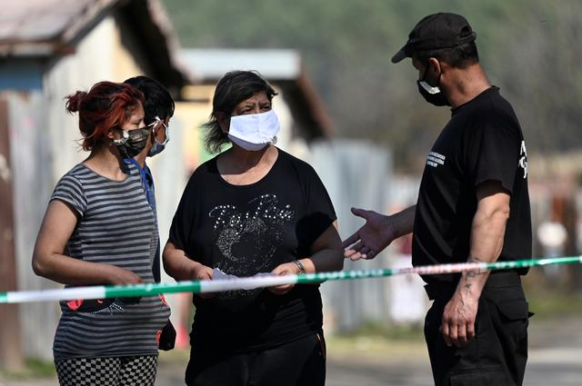 People wearing protective face mask as the coronavirus disease (COVID-19) spreads in the area around Roma settlements, in Krompachy, Slovakia April 9, 2020. REUTERS/Radovan Stoklasa
