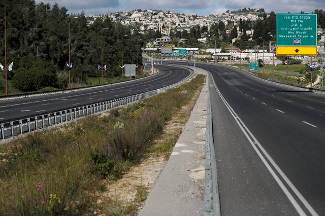 A main road in Jerusalem is seen deserted in the morning of Passover amid coronavirus ( COVID-19) government restrictions April 9, 2020 REUTERS/ Ammar Awad