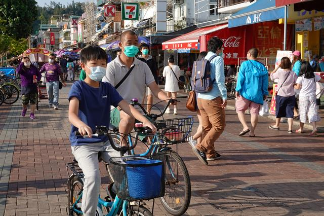 People wearing face masks are seen at Cheung Chau island during Easter weekend, amid the novel coronavirus disease (COVID-19) outbreak, in Hong Kong, China April 12, 2020. REUTERS/Joyce Zhou