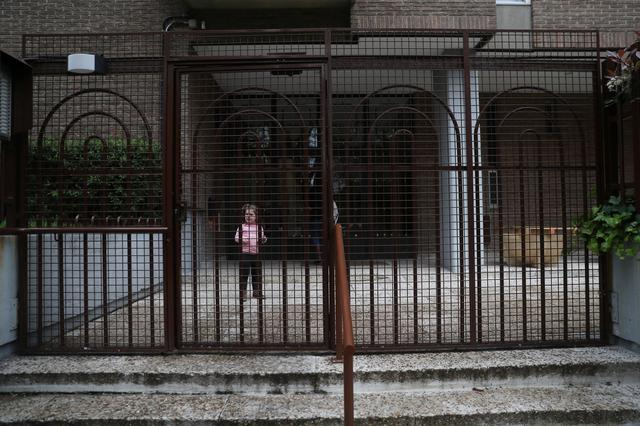Susana Cristo Anzola and her daughter Olivia, a 4-year-old on the autism spectrum, go back to the confinement of their home during the lockdown amid the coronavirus disease (COVID-19) outbreak in Madrid, Spain, April 9, 2020. Picture taken April 9, 2020. REUTERS/Susana Vera